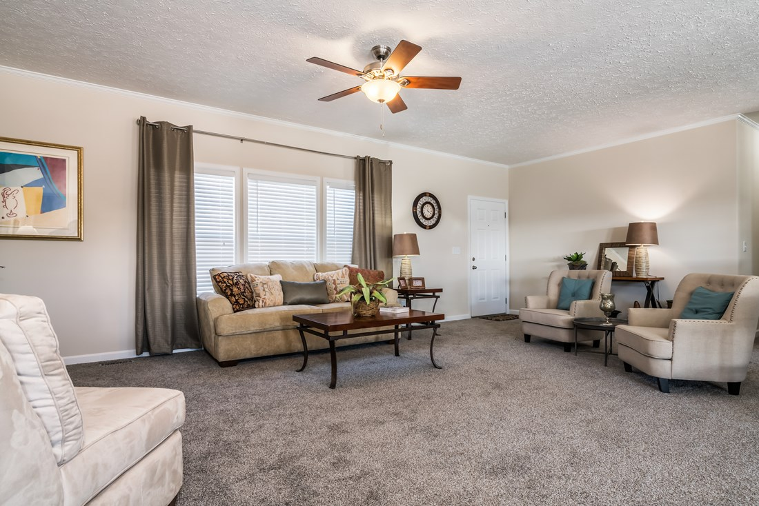 The 3554 JAMESTOWN Living Room. This Manufactured Mobile Home features 4 bedrooms and 2 baths.