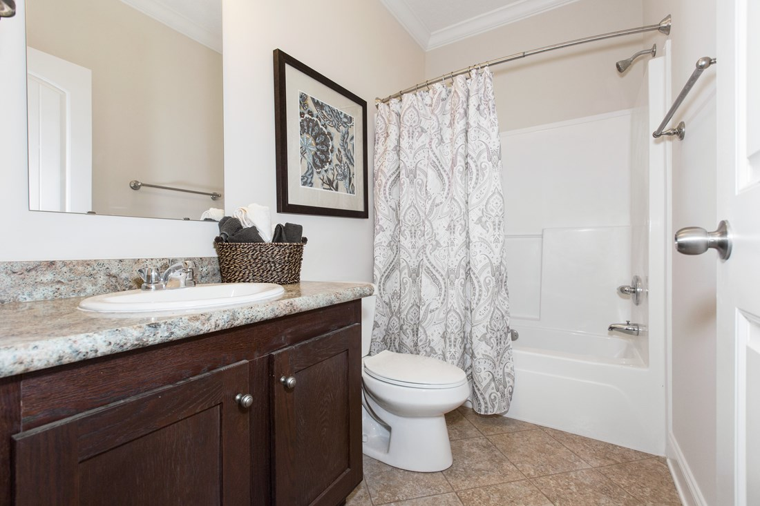 The J533 MOD Guest Bathroom. This Manufactured Mobile Home features 3 bedrooms and 2 baths.