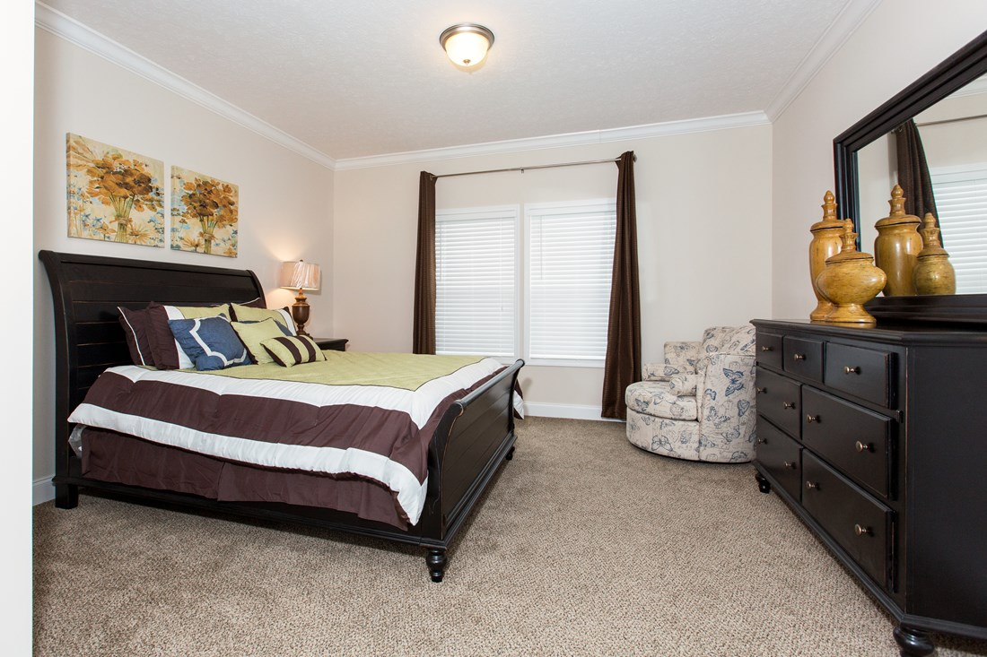 The J533 MOD Master Bedroom. This Manufactured Mobile Home features 3 bedrooms and 2 baths.